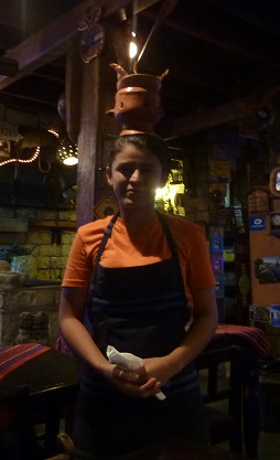 Kebab starter brought out on waitresses head in Copan Ruinas, Honduras