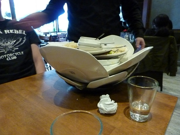 This is how a real man clears away the dirty plates - awesome.